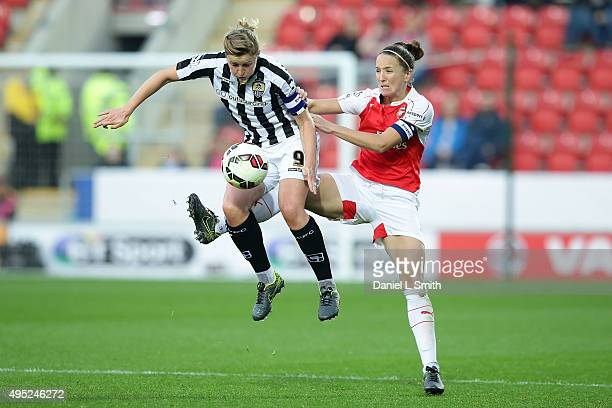 Dominique Janssen of Arsenal Ladies FC jumps in an attempt to gain control of the ball from Ellen White of Notts Ladies County FC during the WSL...