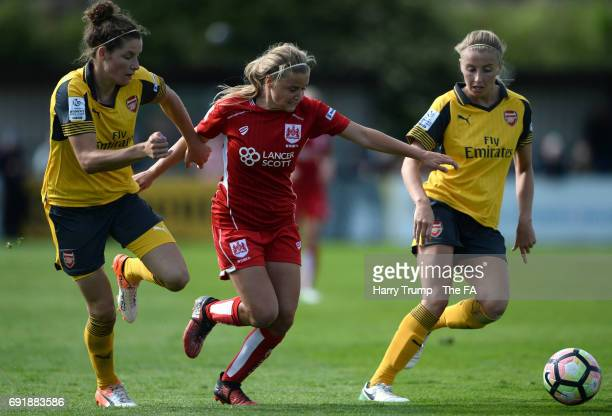 Dominique Janssen of Arsenal Ladies is tackled by Olivia Fergusson of Bristol City Women during the WSL 1 match between Bristol City Women and...