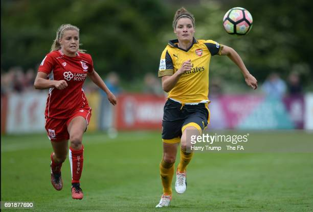 Dominique Janssen of Arsenal Ladies is tracked by Olivia Fergusson of Bristol City Women during the WSL 1 match between Bristol City Women and...