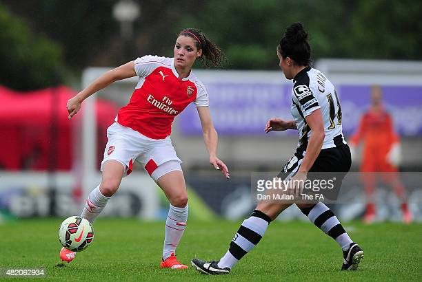 Dominique Janssen of Arsenal takes on Leanne Crichton of Notts County during the WSL match between Arsenal Ladies and Notts County Ladies at Meadow...