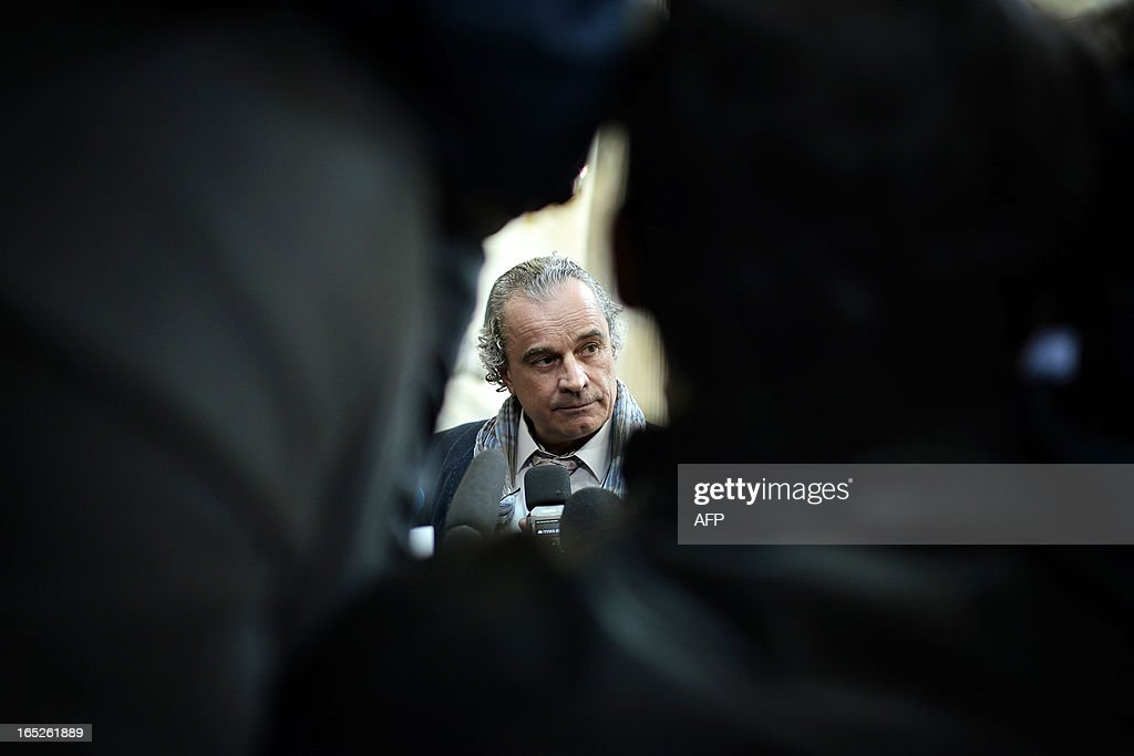 Dominique Jean Lardans, counsel for the plaintiff, answers journalists in Lyon's criminal courtroom, on April 2, 2013, on the opening day of Christophe Khider and Omar Top El Hadj's trial. They are judged for having escaped from jail using explosives and taking hostages two prison staffs. AFP PHOTO / JEFF PACHOUD
