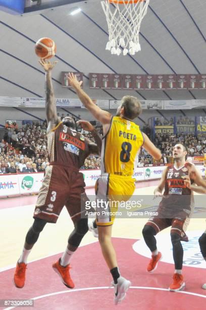 Dominique Johnson and Gediminas Orelik of Umana competes with Giuseppe Poeta of Fiat during the LBA LegaBasket of Serie A match between Reyer Umana...