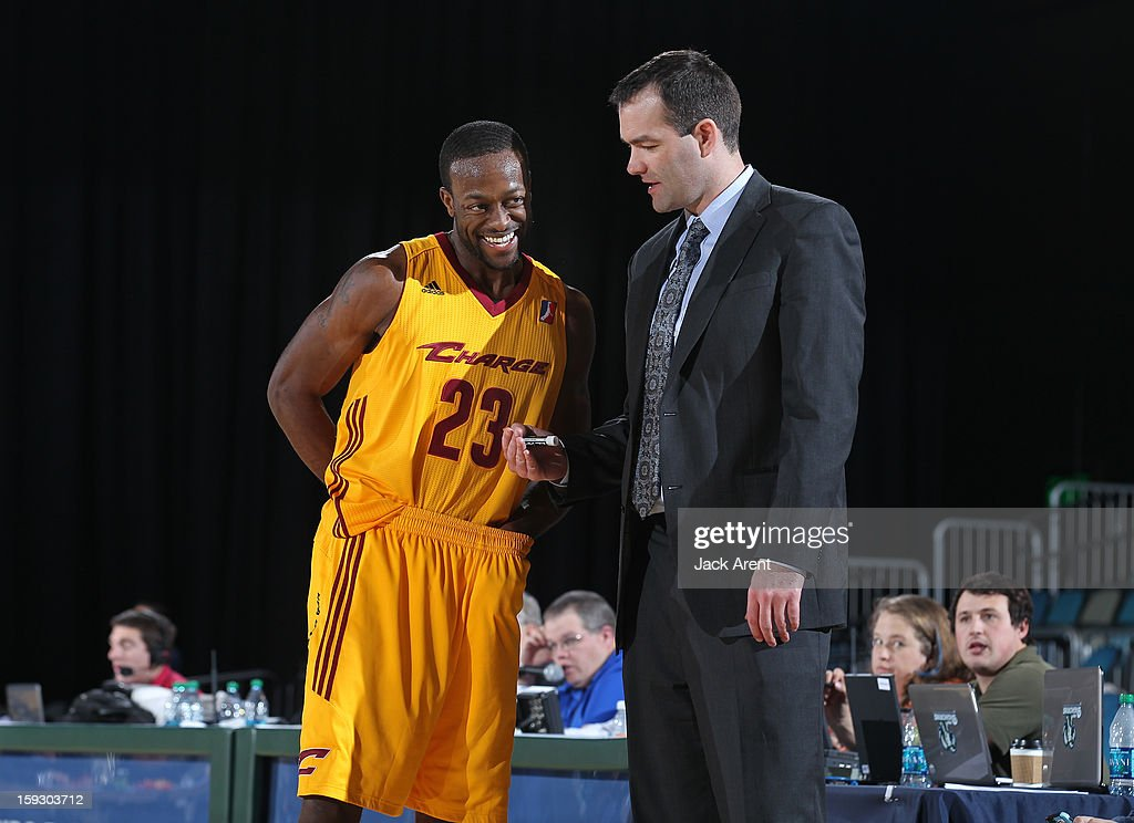 Dominique Johnson #23 of the Canton Charge shares a laugh with Head Coach Alex Jensen against the Santa Cruz Warriors during the 2013 NBA D-League Showcase on January 10, 2013 at the Reno Events Center in Reno, Nevada.