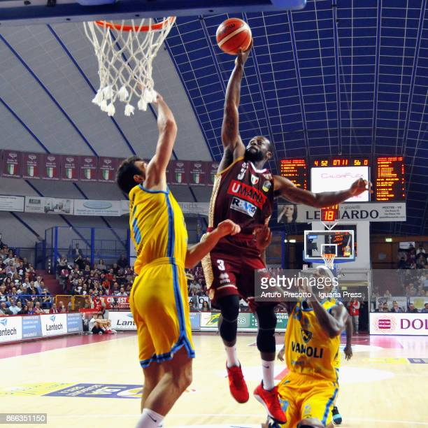 Dominique Johnson of Umana competes with Giampaolo Ricci and Landon Milbourne of Vanoli during the LBA LegaBasket of Serie A match between Reyer...
