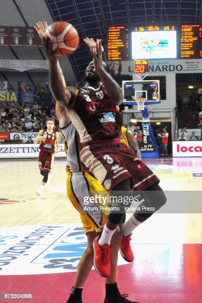 Dominique Johnson of Umana competes with Valerio Mazzola of Fiat during the LBA LegaBasket of Serie A match between Reyer Umana Venezia and Auxilium...