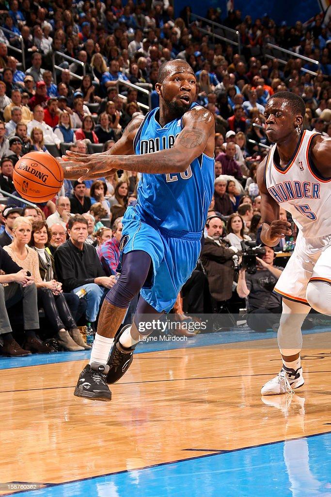Dominique Jones #20 of the Dallas Mavericks drives against Reggie Jackson #15 of the Oklahoma City Thunder on December 27, 2012 at the Chesapeake Energy Arena in Oklahoma City, Oklahoma.