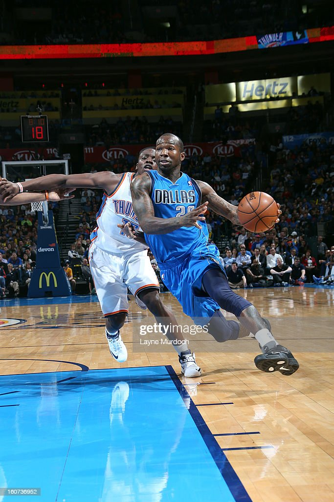 Dominique Jones #20 of the Dallas Mavericks drives to the basket against Reggie Jackson #15 of the Oklahoma City Thunder on February 4, 2013 at the Chesapeake Energy Arena in Oklahoma City, Oklahoma.
