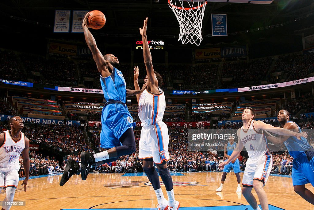 Dominique Jones #20 of the Dallas Mavericks rises for a dunk against Hasheem Thabeet #34 of the Oklahoma City Thunder on December 27, 2012 at the Chesapeake Energy Arena in Oklahoma City, Oklahoma.