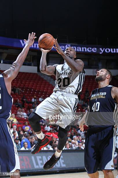 Dominique Jones of the Milwaukee Bucks splits defense during the NBA Summer League game between the Milwaukee Bucks and the New Orleans Pelicans on...