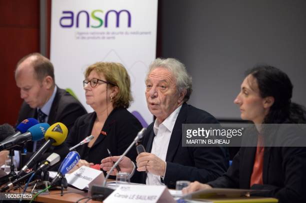 Dominique Maraninchi head of France's regulator the National Agency for the Safety of Drugs and Health Products speaks next to Ansm staff members...