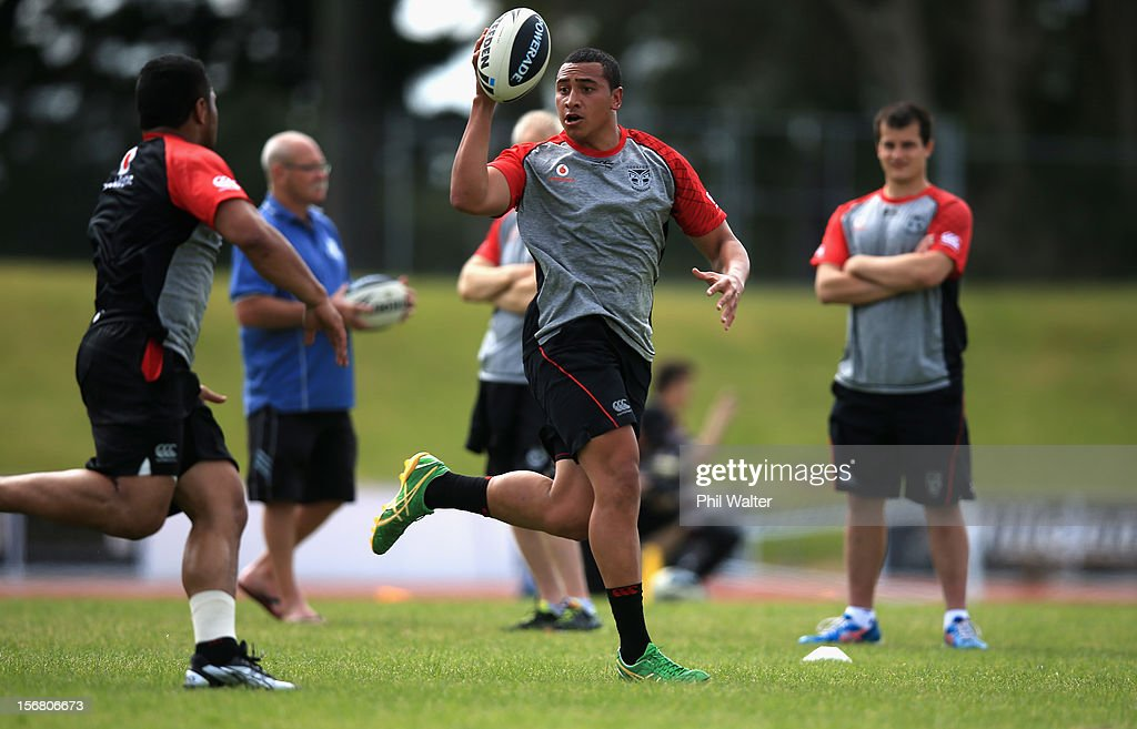 Dominique Peyroux of the Warriors passes during a New Zealand Warriors NRL pre-season training session at the Millenium Institute on November 22, 2012 in Auckland, New Zealand.