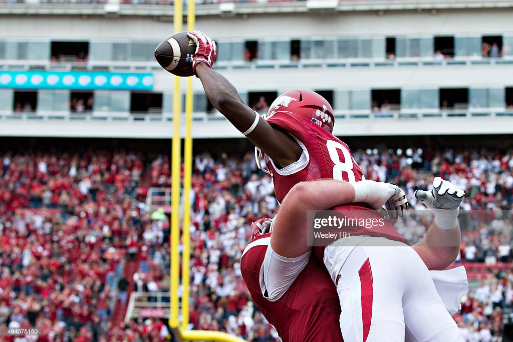Dominique Reed of the Arkansas Razorbacks celebrates after scoring a touchdown in the first half of a game against the Arkansas Razorbacks at...