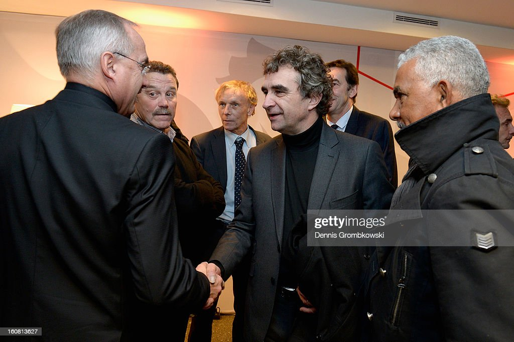Dominique Rocheteau of France and <a gi-track='captionPersonalityLinkClicked' href=/galleries/search?phrase=Uli+Stielike&family=editorial&specificpeople=746980 ng-click='$event.stopPropagation()'>Uli Stielike</a> of Germany joke during a meeting of the 1982 World Cup teams of France and Germany on February 6, 2013 in Paris, France.