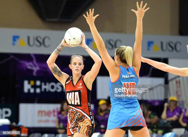 Dominique Scott of the Storm looks to pass during the round seven Australian Netball League match between the Storm and the Waratahs at University of...