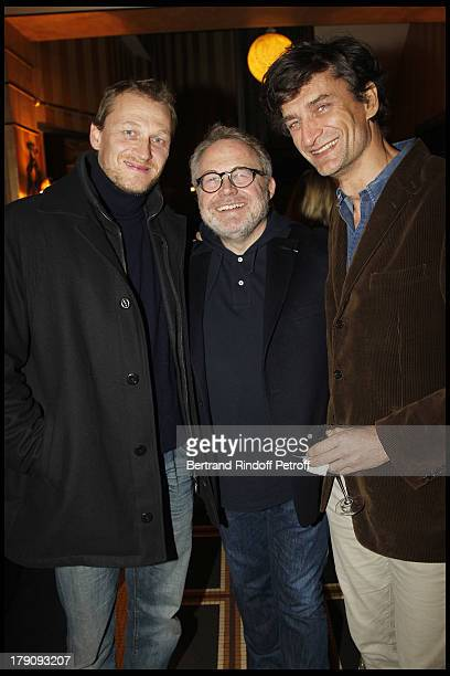 Dominique Segall in between the brothers Nicolas and Eric Altmayer at The 60th Birthday Celebration Of Dominique Segall At Mathys Restaurant In Paris