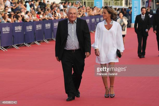 Dominique StraussKahn and Myriam L'Aoufir arrive at the closing ceremony and the 'Sin City A Dame To Kill For' premiere of during the 40th Deauville...
