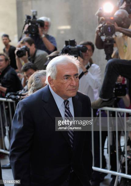 Dominique StraussKahn arrives at Manhattan Criminal Court to attend a status hearing on the sexual assault charges against StraussKahn on August 23...