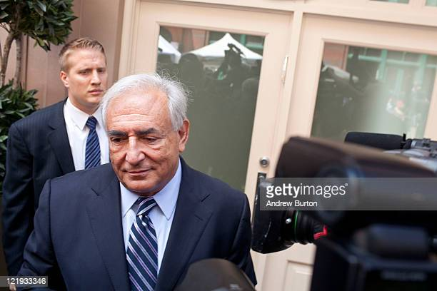 Dominique StraussKahn former head of the International Monetary Fund speaks to reporters outside his residence at 153 Franklin Street on August 23...