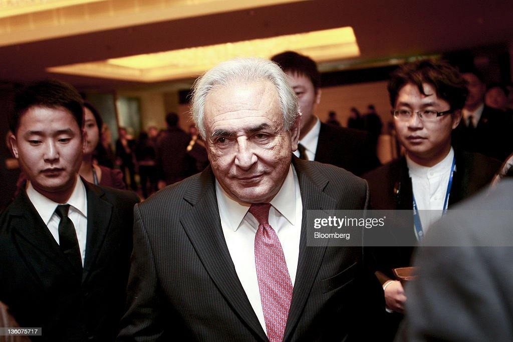 <a gi-track='captionPersonalityLinkClicked' href=/galleries/search?phrase=Dominique+Strauss-Kahn&family=editorial&specificpeople=227268 ng-click='$event.stopPropagation()'>Dominique Strauss-Kahn</a>, former managing director of the International Monetary Fund, arrives at an economic forum in Beijing, China, on Monday, Dec. 19, 2011. Strauss-Kahn said he hopes the Group of 20 Nations and the IMF can merge functions and simplify global coordination. Photographer: Nelson Ching/Bloomberg via Getty Images