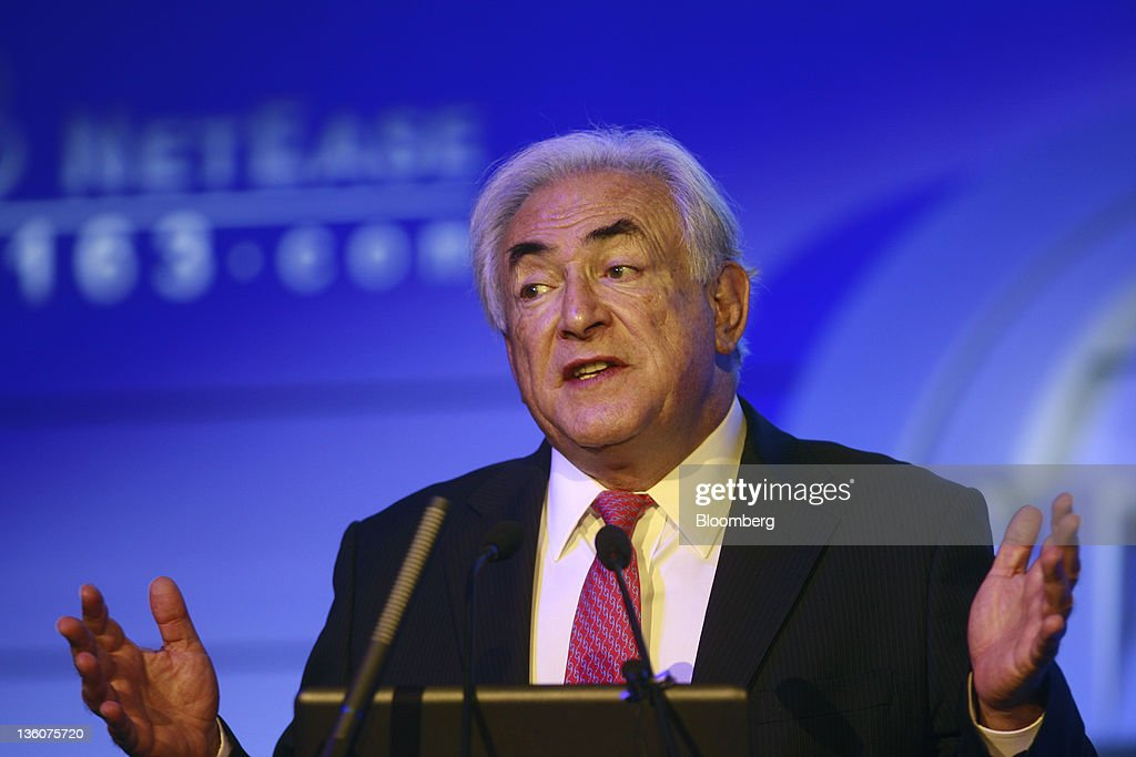 <a gi-track='captionPersonalityLinkClicked' href=/galleries/search?phrase=Dominique+Strauss-Kahn&family=editorial&specificpeople=227268 ng-click='$event.stopPropagation()'>Dominique Strauss-Kahn</a>, former managing director of the International Monetary Fund, gestures as he speaks at an economic forum in Beijing, China, on Monday, Dec. 19, 2011. Strauss-Kahn said he hopes the Group of 20 Nations and the IMF can merge functions and simplify global coordination. Photographer: Nelson Ching/Bloomberg via Getty Images