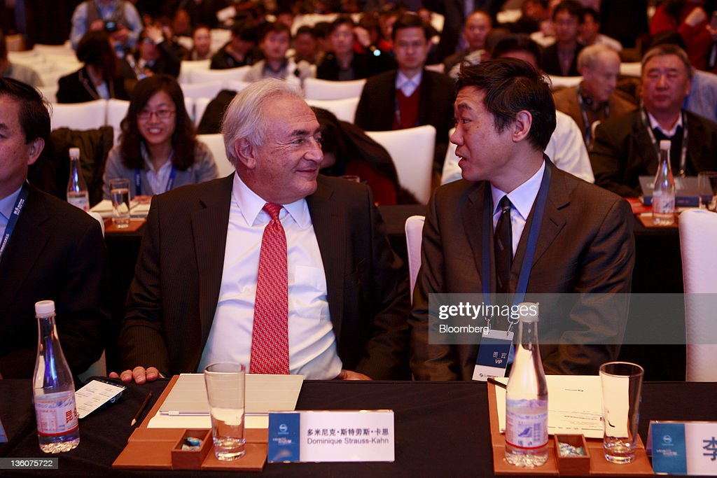 <a gi-track='captionPersonalityLinkClicked' href=/galleries/search?phrase=Dominique+Strauss-Kahn&family=editorial&specificpeople=227268 ng-click='$event.stopPropagation()'>Dominique Strauss-Kahn</a>, former managing director of the International Monetary Fund, left, speaks with Li Daokui, adviser to the People's Bank of China, at an economic forum in Beijing, China, on Monday, Dec. 19, 2011. Strauss-Kahn said he hopes the Group of 20 Nations and the IMF can merge functions and simplify global coordination. Photographer: Nelson Ching/Bloomberg via Getty Images