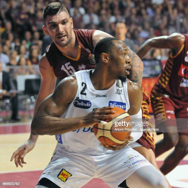Dominique Sutton of Dolomiti competes with Esteban Batista of Umana during the match game 2 of play off final series of LBA Legabasket of Serie A1...