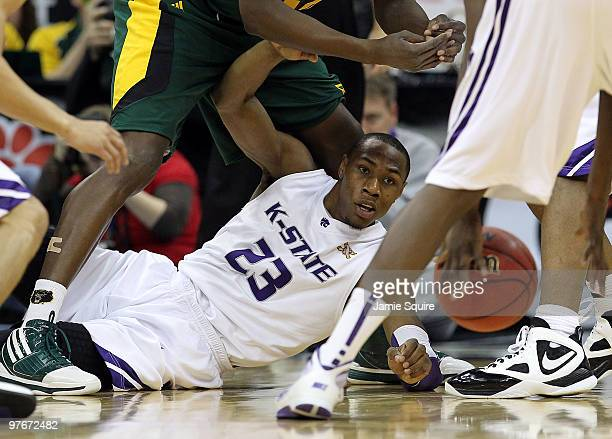Dominique Sutton of the Kansas State Wildcats dives for a loose ball during the semifinals of the 2010 Phillips 66 Big 12 Men's Basketball Tournament...