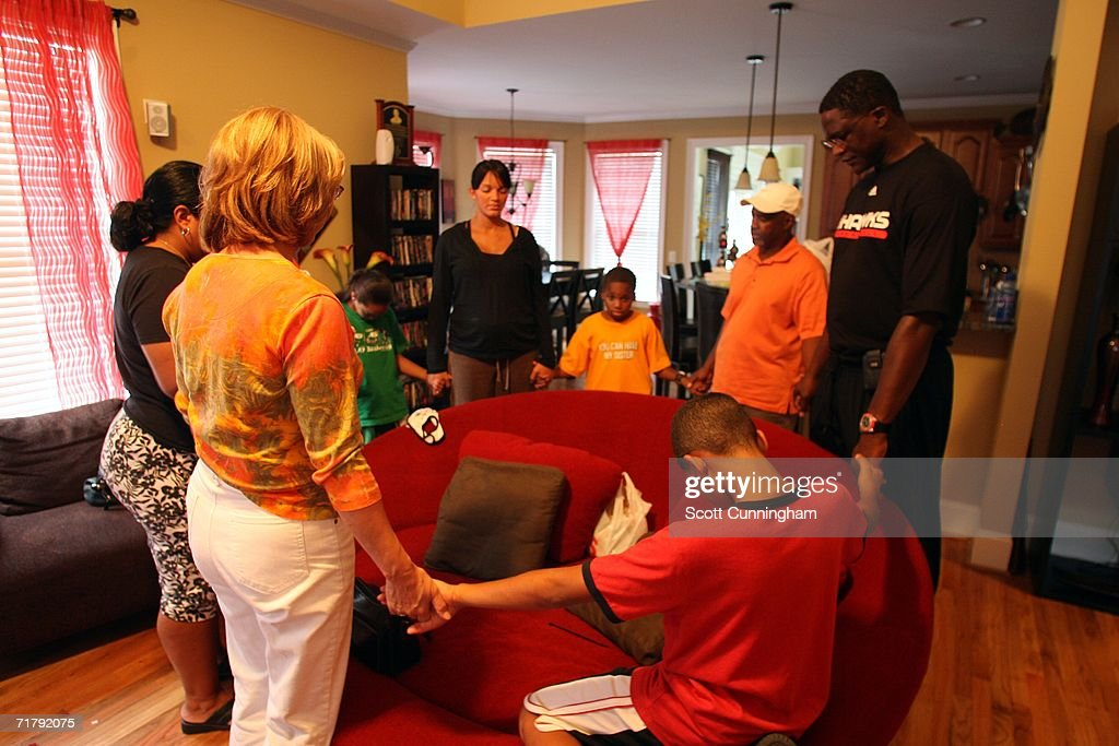 Dominique Wilkins (R) and members of his family pray in their home before leaving for Springfield, Massachusetts for his induction into the Basketball Hall Of Fame iSeptember 5, 2006 in Atlanta, Georgia.