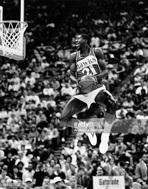 Dominique Wilkins of the Atlanta Hawks attempts a dunk during the 1985 NBA Slam Dunk Contest on February 9 1985 at Market Square Arena in...