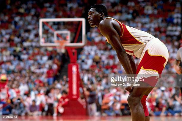 Dominique Wilkins of the Atlanta Hawks catches his breath against the Los Angeles Clippers during a 1989 NBA game played at the Los Angeles Memorial...