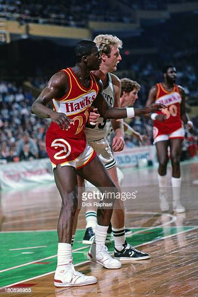 Dominique Wilkins of the Atlanta Hawks competes for post position with Larry Bird of the Boston Celtics during a game circa 1986 at the Boston Garden...