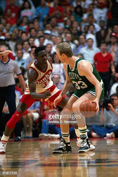 Dominique Wilkins of the Atlanta Hawks defends against Larry Bird of the Boston Celtics during the NBA game in Atlanta Georgia NOTE TO USER User...