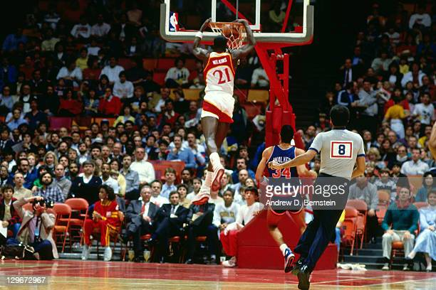 Dominique Wilkins of the Atlanta Hawks dunks against the New York Knicks circa 1987 at the Omni in Atlanta Georgia NOTE TO USER User expressly...