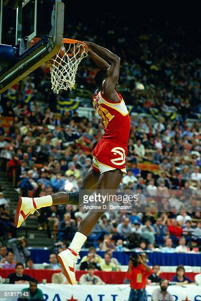 Dominique Wilkins of the Atlanta Hawks dunks during the Gatorade Slam Dunk Championship during the 1984 NBA AllStar Weekend on January 29 1984 in...