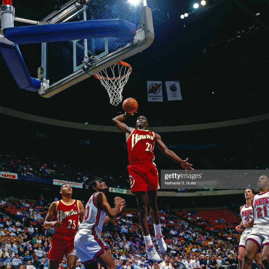 Dominique Wilkins of the Atlanta Hawks goes for a dunk against the New Jersey Nets during the NBA game circa 1993 in East Rutherford New Jersey NOTE...