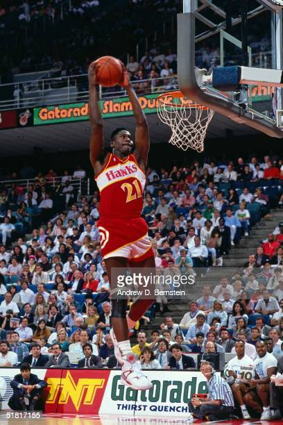 Dominique Wilkins of the Atlanta Hawks goes for a dunk during the Gatorade Slam Dunk Championship during the 1989 NBA AllStar Weekend at the...