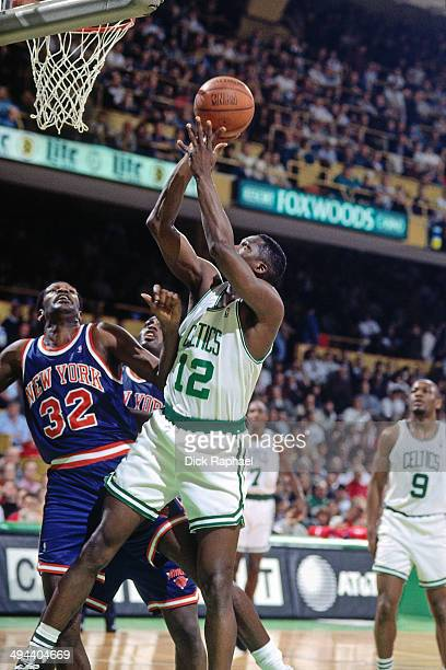 Dominique Wilkins of the Boston Celtics shoots the ball against the New York Knicks during a game played in 1995 at the Boston Garden in Boston...