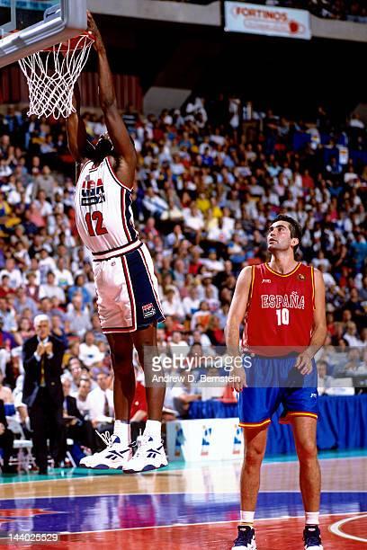 Dominique Wilkins of the USA Senior Men's National Team dunks against the Spain Senior Men's National Team during the 1994 World Championships of...