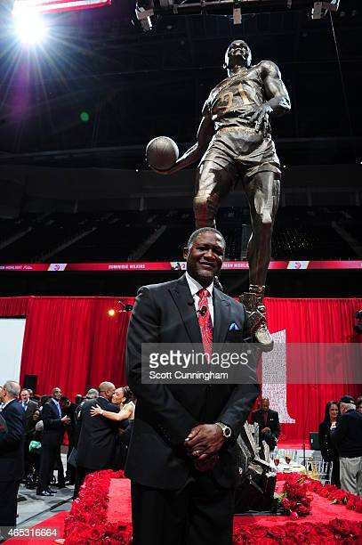 Dominique Wilkins stands in front of his statue at the Unveiling Ceremony on March 5 2015 at Philips Arena in Atlanta Georgia NOTE TO USER User...
