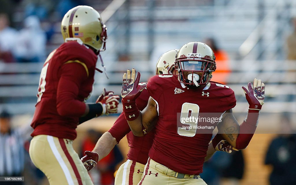 Dominique Williams #9 celebrates with teammate Bryce Jones #19 of the Boston College Eagles after a defensive stop against the Virginia Tech Hokies during the game on November 17, 2012 at Alumni Stadium in Chestnut Hill, Massachusetts.