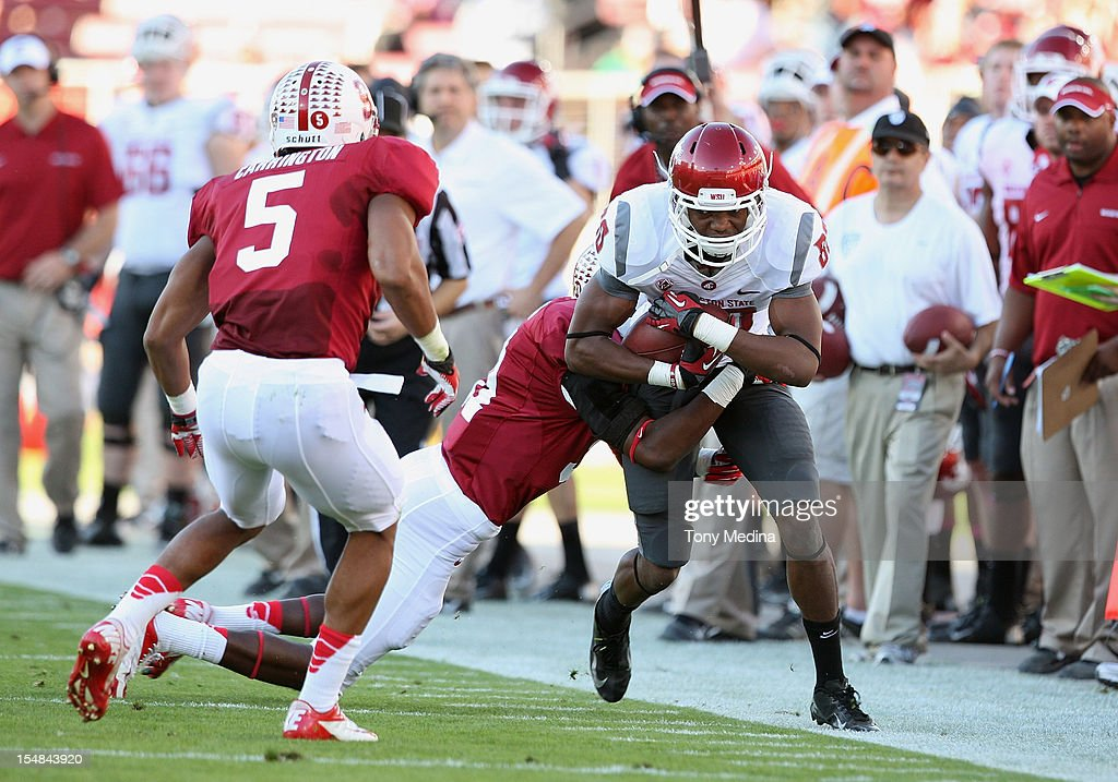 Dominique Williams #80 of the Washington State Cougars is forced out of bounds after making a reception during the first half as the Stanford Cardinal lead the Washington State Cougars 10-7 at Stanford Stadium on October 27, 2012 in Palo Alto, California.
