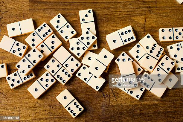 Domino tiles on wooden surface, studio shot