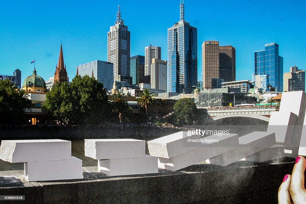 Dominoes collapse along a ledge during the Arts Centre Melbournes Dominoes arts project in Melbourne, Australia February 6, 2016. More than 7000 giant dominoes snaked through Melbourne city over 2km.