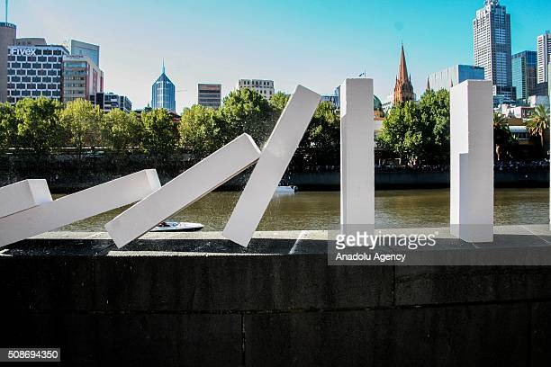 Dominoes fall along a ledge along the yarra river in Southbank during the Arts Centre Melbournes Dominoes arts project in Melbourne Australia...