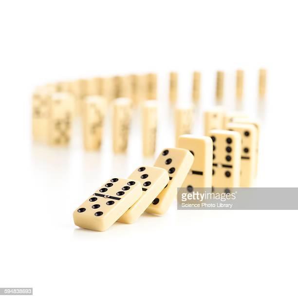 Dominoes falling down