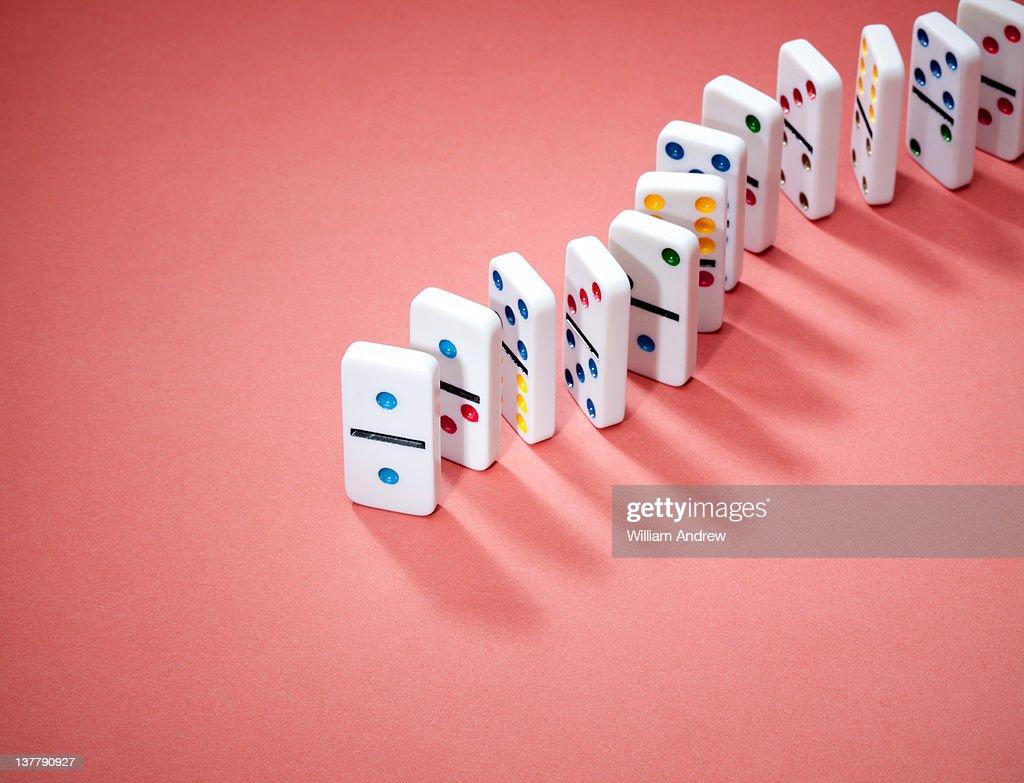Dominoes in row : Stock Photo