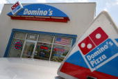 A Domino's Pizza store April 14 2004 in Miami Florida Domino's Pizza is looking to raise $300 million in the stock market by listing on the New York...