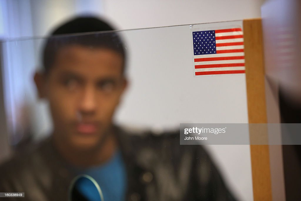 Domminican immigrant Yordi Guzman, 16, awaits an interview for his U.S. citizenship application at the U.S. Citizenship and Immigration Services (USCIS), district office on January 29, 2013 in New York City. Some 118,000 immigrants applied for U.S. citizenship and 2,500 children received citizenship certificates in the New York City dictrict in 2012. Although minors of naturalized immigrants usually receive U.S. citizenship, they must go through a process at the USCIS in order to receive legal certificates.