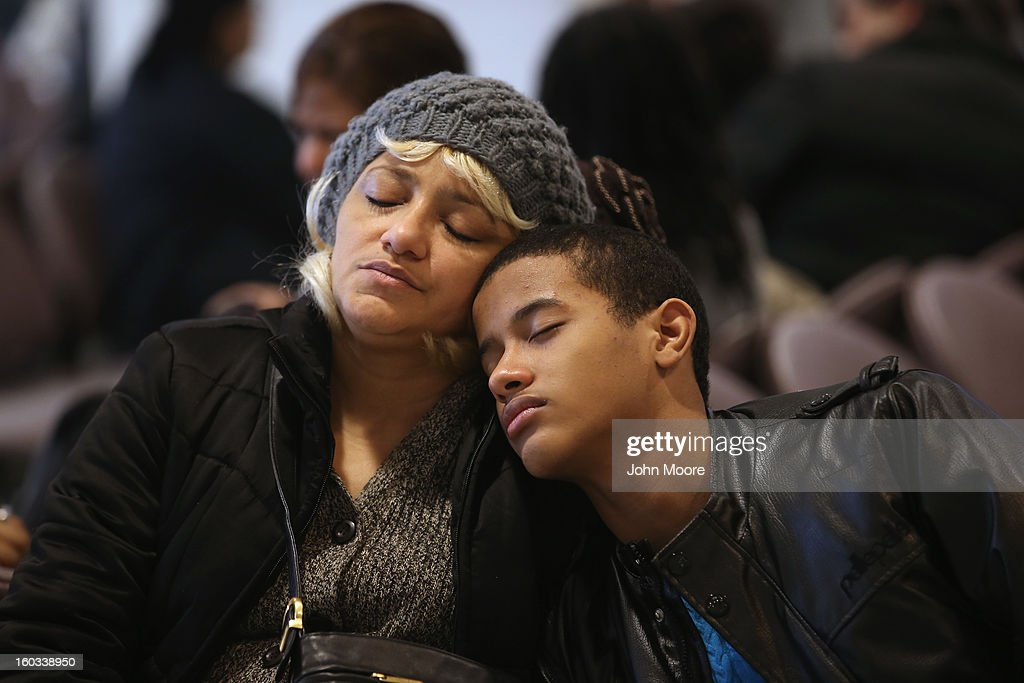 Domminican immigrant Yordi Guzman, 16, sleeps against his mother Hingrid Guzman while awaiting an interview for his U.S. citizenship application at the U.S. Citizenship and Immigration Services (USCIS), district office on January 29, 2013 in New York City. Some 118,000 immigrants applied for U.S. citizenship in the New York City district, and 2,500 children received citizenship certificates there in 2012. Although minors of naturalized immigrants usually receive U.S. citizenship, they must go through a process at the USCIS in order to receive legal certificates.
