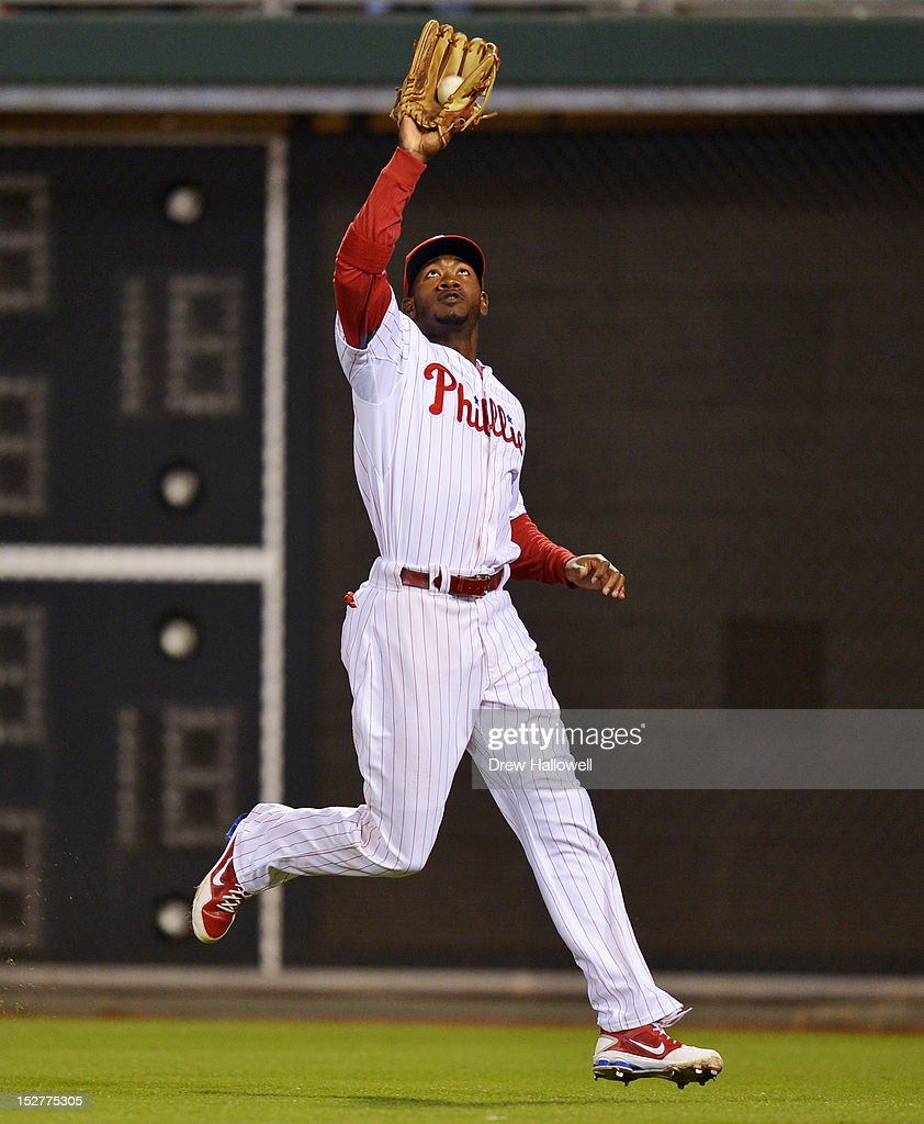 Domonic Brown #9 of the Philadelphia Phillies catches a fly ball during the game against the Washington Nationals at Citizens Bank Park on September 25, 2012 in Philadelphia, Pennsylvania.